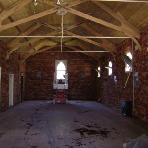 Indoor abrasive blasting of brickwork