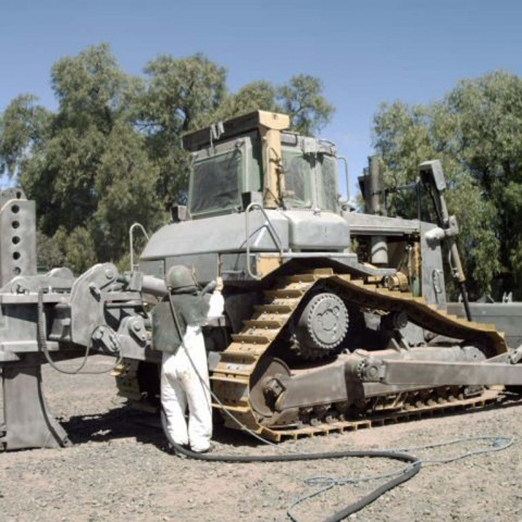 Blast and spray painting bulldozer
