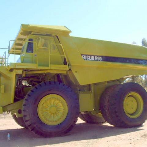 Spray painting mining trucks
